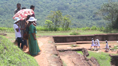 View of people passing by on Sigiriya, an ancient palace in Sri Lanka. Stock Footage