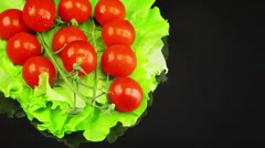 The tomatoes are on a salad leaf and ' round Stock Footage
