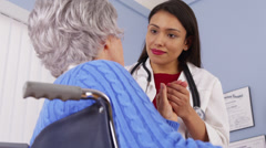 Elderly patient thanking Mexican woman doctor Stock Footage