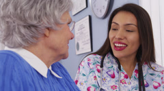 Mexican caregiver and senior patient talking together - stock footage