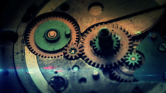 4K macro shot of clock gears with composited animation elements. Stock Footage