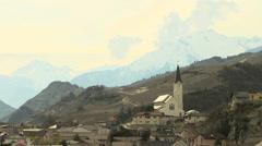 SWITZERLAND Valais village church and Alpine mountains Stock Footage