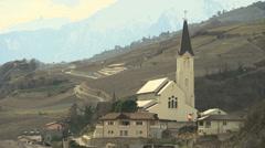 SWITZERLAND Valais village church and Alpine mountains 2 Stock Footage