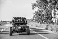 Stock Photo of kos, greece - may 7, 2014: quad vehicle speeds up in island road. quad is the