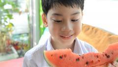 Little asian cute boy eats ripe watermelon . Stock Footage