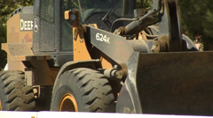 Street construction bulldozer backing up Stock Footage