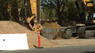 Stock Video Footage of street construction bulldozer digging then dumping into truck