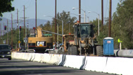 Stock Video Footage of street construction equipment and traffic close