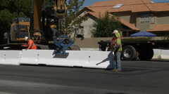 Street construction setting barrier close Stock Footage