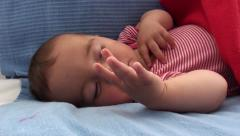Baby moving hands and fingers asleep Stock Footage