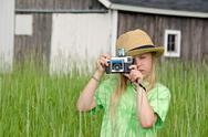 Stock Photo of little girl with old-fashioned camera