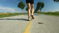 Following running woman Stock Footage