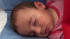 Face of sleeping 6 months old baby 2 - stock footage