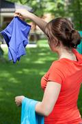 Stock Photo of young mum hanging the laundry