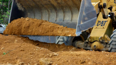 Earthmover dozer doing earthmoving works outdoors. Video Stock Footage