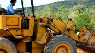 Stock Video Footage of Earthmover dozer doing earthmoving works outdoors. Video