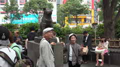 Posing in front of the Hachiko statue at Shibuya station Stock Footage