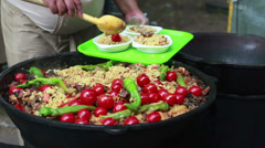 Сhef puts on a dish delicious pilaf. - stock footage