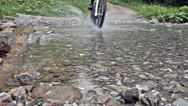 Stock Video Footage of mountain bike crossing creek