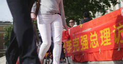 Protest to Chinese Premier Li Keqiang at Downing St - out focus protesters 4K Stock Footage