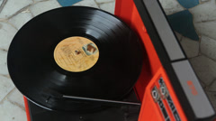 1970's turntable plays vinyl record on the floor 2 Stock Footage