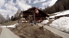 Pan view with hotel-restaurant at Zermatt Matterhorn alps Stock Footage