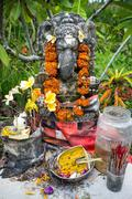 Temple offerings on a shrine to hindu god, bali, indonesia Stock Photos
