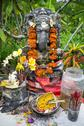 Stock Photo of temple offerings on a shrine to hindu god, bali, indonesia