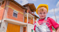 Cute Boy Portrait With Helmet and House in Background Footage
