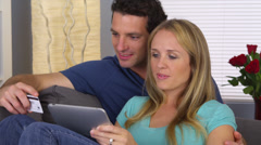 Couple browsing the web on tablet Stock Footage