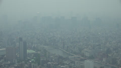 Early afternoon smog and haze over Tokyo - stock footage