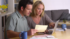 Couple managing their bills Stock Footage