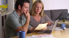 Couple overwhelmed with bills - stock footage