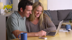 Couple looking for vacation getaways on laptop - stock footage