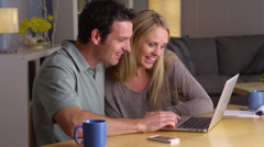 Happy couple surfing the internet together Stock Footage