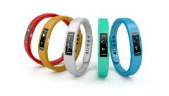 Fitness trackers with different interfaces and colors Stock Footage