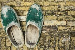 old dutch clogs on a brick background - stock photo