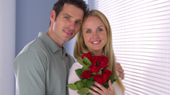 Beautiful couple with roses Stock Footage