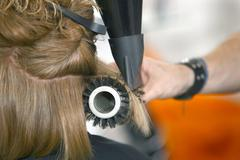 Drying the hair with a brush in the salon Stock Photos