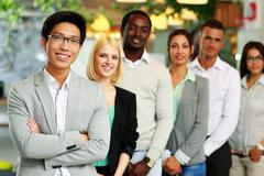 portrait of a smiling group business people - stock photo