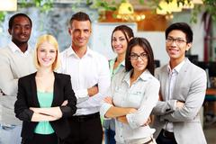 Happy group of co-workers standing in office Stock Photos