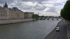 France, Paris, embenkment of river Seine, Conciergerie  and Pont Neuf. Stock Footage