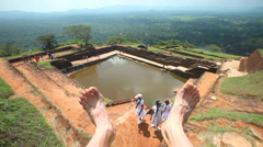 View of the Rock Fortress top in Sigiriya with man's feet in sight. Stock Footage