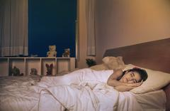 Girl sleeping on the bed Stock Photos