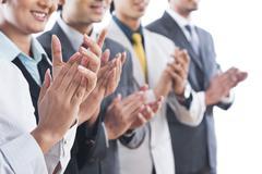 business executives applauding - stock photo