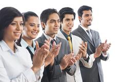 business executives applauding - stock photo
