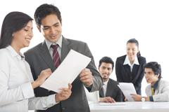business executives working in an office - stock photo
