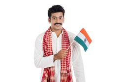 portrait of a man holding national flag of india - stock photo