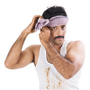 Portrait of a farmer tying cloth on his head Stock Photos