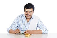portrait of a south indian man counting money - stock photo